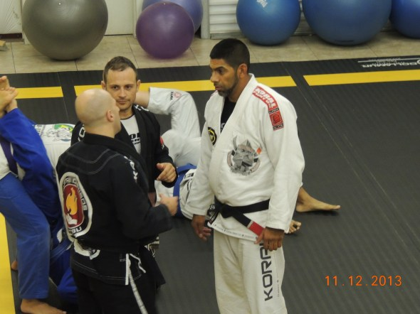 Discussing technique with Professor Sal and Instructor Sean