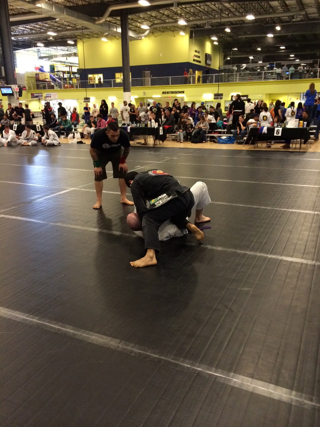 Ivan with the knee on belly on the purple belt absolute division