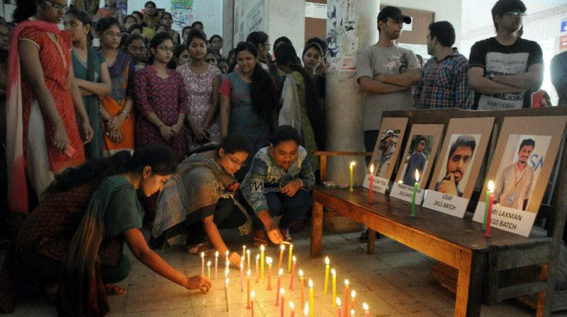 Osmania General Hospital medical students and colleagues of the deceased medicos lighting candles mourning the death of the four medicos on Monday night. 	— Deccan Chronicle