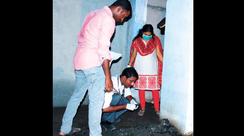 Forensic experts collecting evidence from the warehouse in Chengannur on Saturday (Photo: DC)