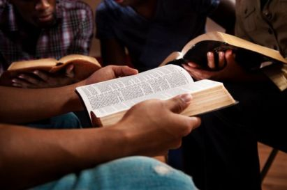 a bible study gathers students to read the word of the lord