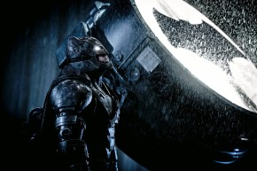 THE NEXT ONE IS A SIDE SHOT OF BATMAN TURNING ON THE BAT SIGNAL