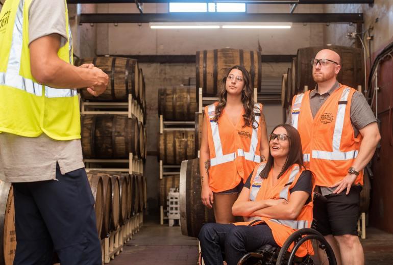 Three workers in orange reflective vests