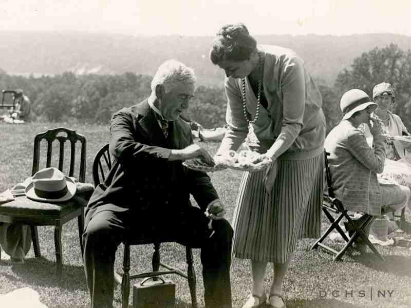 John Mylod accepts the hospitality of Eleanor Roosevelt.