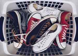 laundry basket of sneakers