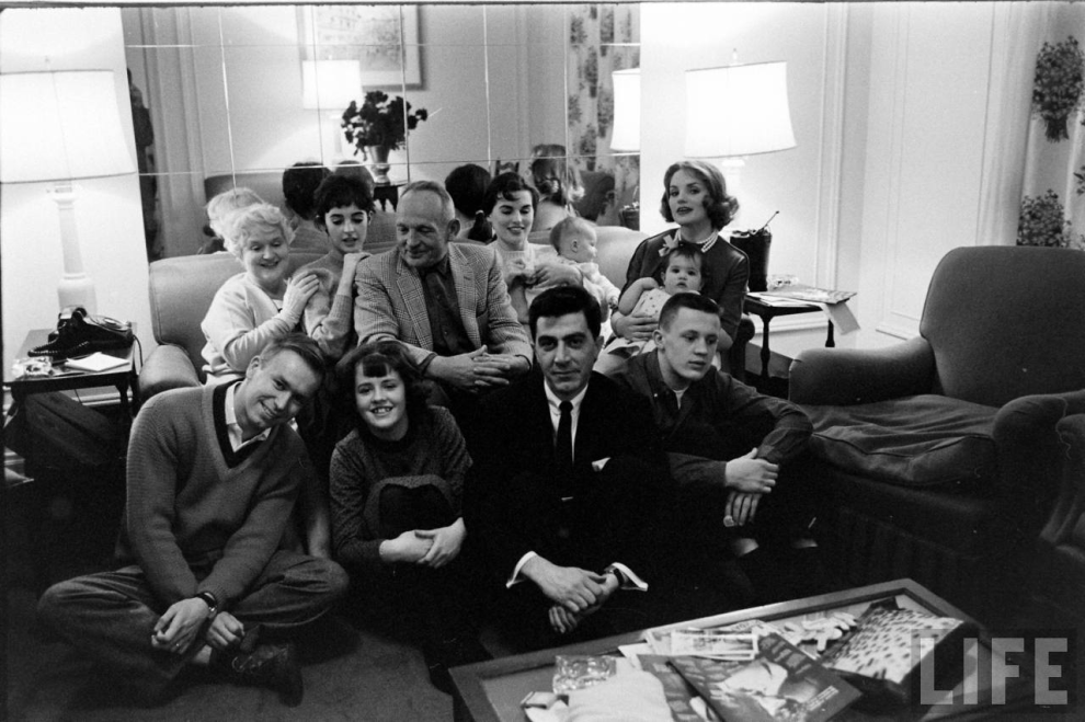 """""""My mom is in the upper far right, she is holding me on her lap. I was about 10 months old. Millie is second from top left between my grandparents. Dad is sitting down in the front wearing a dark suit"""""""