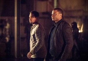 "Arrow -- ""Sins of the Father"" -- Image AR413b_0161b.jpg -- Pictured (L-R):  Stephen Amell as Oliver Queen and David Ramsey as John Diggle -- Photo: Dean Buscher/ The CW -- © 2016 The CW Network, LLC. All Rights Reserved."