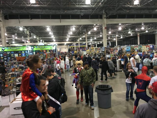 Bustling fans fill the showfloor of the Suburban Collection Showplace.