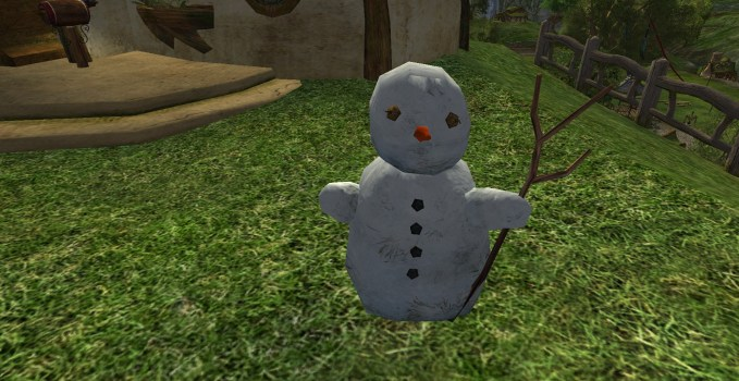Bonhomme de neige avec un bâton