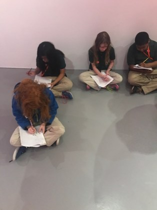 Students analyse Yayoi Kusama's Infinity Mirrors exhibit.