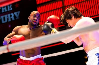 Terence Archie as Apollo Creed and Andy Karl as Rocky