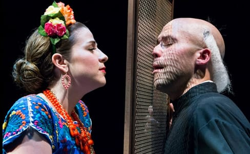 Alex Mansoori smitten by Catherine Martin through a confessional screen in Lucrezia (Photo courtesy of UrbanArias)