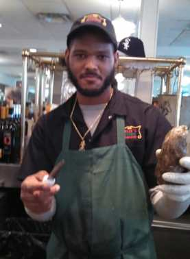 Bugga, professional oyster shucker at Felix's Oyster House in the French Quarter
