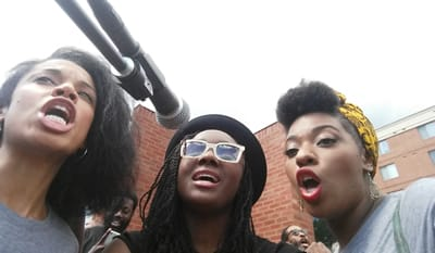 On Saturday, May 2nd, the Marley cast took time from rehearsals to bring Bob Marley's music to  the residents of Sandtown-Winchester, one of the sites of the Baltimore riots. Saycon Sengbloh (center) sings with Susan Kelechi Watson and Crystal Joy.