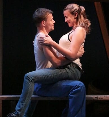 Josiah Bania (Maks) and Alexandra Henrikson (Darja) in Round House Theatre's production of IRONBOUND (Photo: Cheyenne Michaels