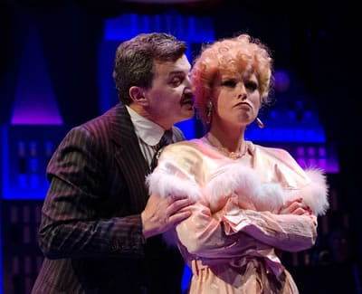 Paul Binotto as Nathan Detroit and Lauren Weinberg as Miss Adelaide in Olney Theatre Center's production of GUYS AND DOLLS. (Photo: Stan Barouh)