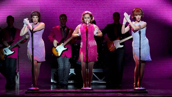 """My Boyfriends Back: Foreground: (l to r) Lauren Tartaglia, Leslie Rochette, and Jaycie Dotin Background: Guitars (l to r): Keith White, Tommaso Antico, and Dru Serkes in Jersey Boys at the National Theatre (Photo: Jeremy Daniel)"