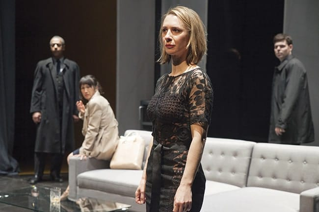 Foreground: Julia Coffey. Background: Michael Early, Kimiye Corwin, and Avery Clark in Hedda Gabler at Studio Theatre. (Photo: Allie Dearie)