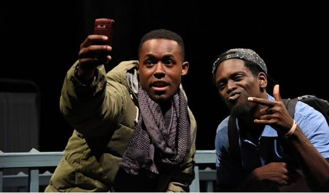 (l-r) Vaughn Ryan Midder as Jeron and Jeremy Keith Hunter as Devaun in When January Feels Like Summer at Mosaic Theater Company of DC. (Photo by Stan Barouh)
