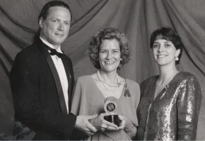 Keith and Pat Murphy Sheehy, with a representative of the Washington Post (far right) after accepting the Washington Post Award for Distinguished Community Service on behalf of Source at the 1993 Helen Hayes Awards.