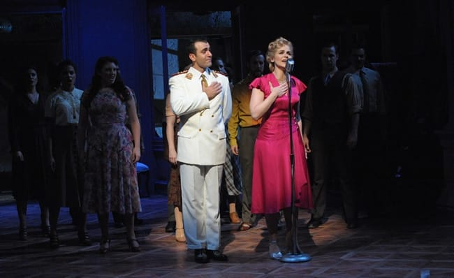 Nick Duckart as Juan Perón, Rachel Zampelli as Eva, and the cast of Olney Theatre Center's production of Evita. (Photo: Stan Barouh)