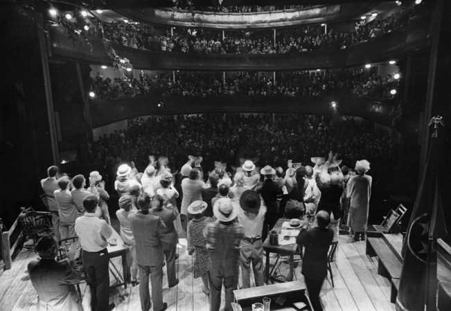 Cast and audience give each other a standing ovation following a performance of Inherit the Wind, directed by Zelda Fichandler, at Moscow Art Theatre 1973. Photo courtesy Arena Stage.