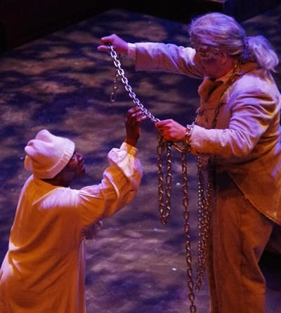 Gregory Burgess as Scrooge, Michael P. Sullivan as Jacob Marley in A Christmas Carol at Chesapeake Shakespeare. (Photo courtesy of Chesapeake Shakespeare)