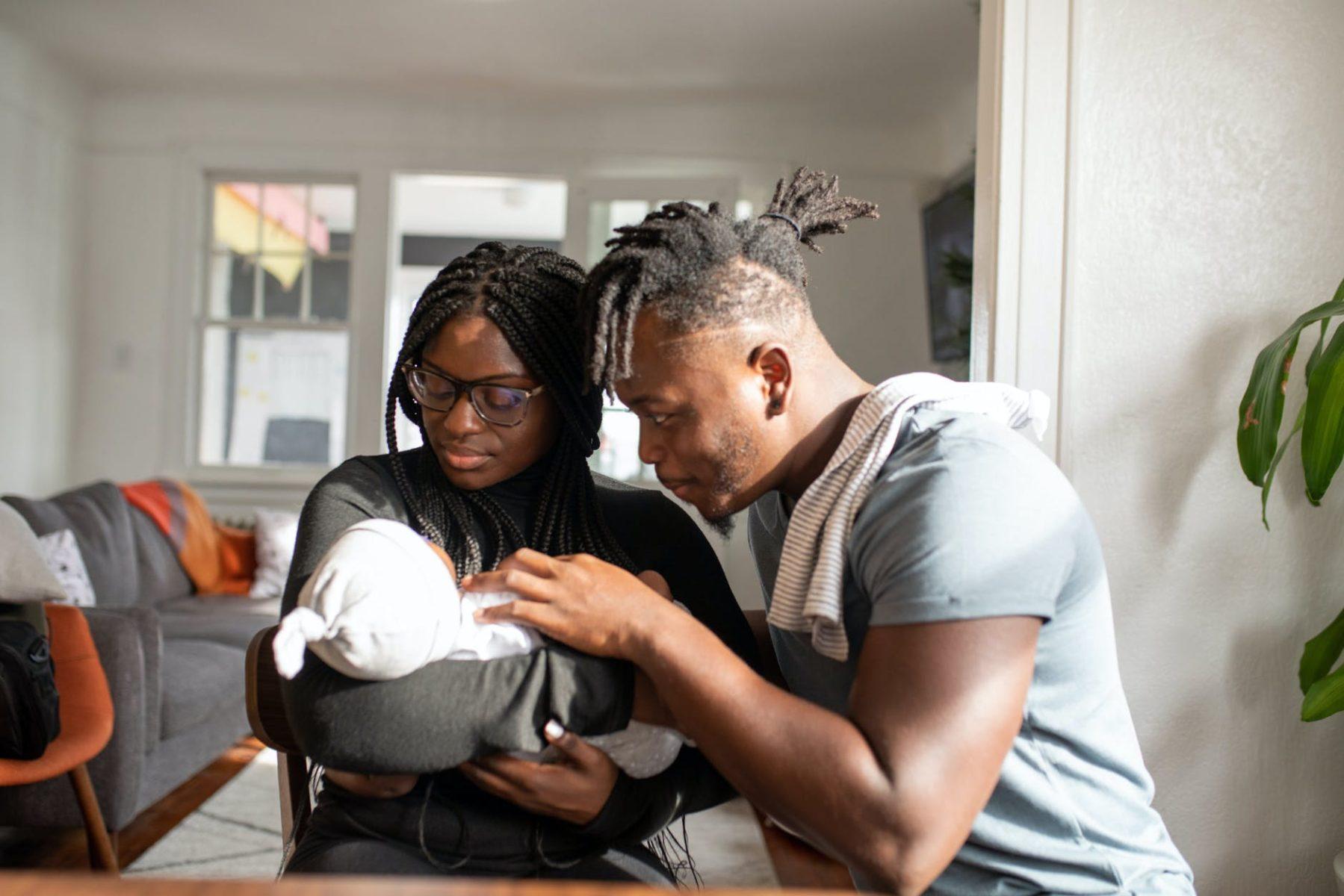 infant adoption parents holding child
