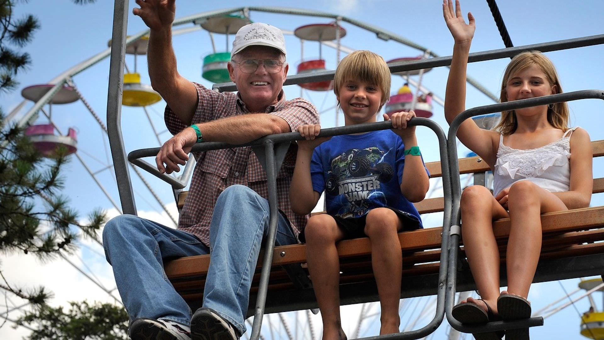 Photo of grandfather and grandson on a ride