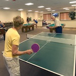 Photo of a grandmother playing Ping Pong