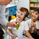 teacher-holding-test-tube