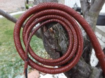 Two Cowhide Bolsters, Two Cowhide Braided Bellies, and Braided Cowhide Overlay.