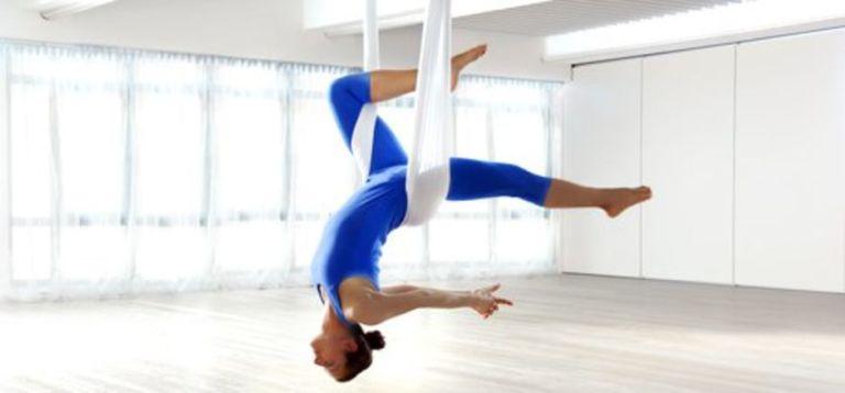 3 cosas que suceden a su cuerpo cuando usted intenta yoga aéreo
