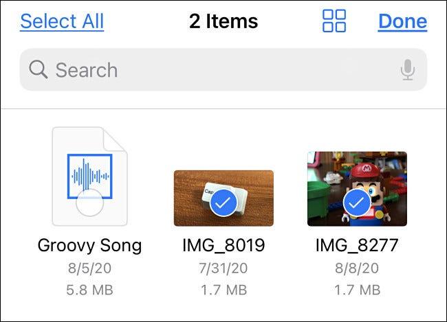 Wählen Sie die Dateien oder Videos aus, die Sie in Fotos kopieren möchten.