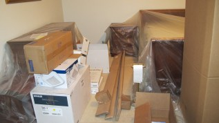 Boxes take over my master bedroom.