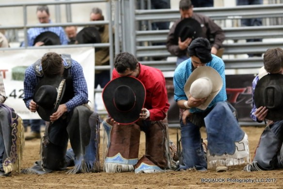 Photo of cowboys kneeling during prayer is provided by BQGAUCK Photography and used with permission.