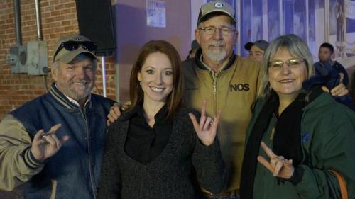 Larry Gillett, Dana Felps, John and Sheryl Meador at Saturday's Concho Christmas Celebration. They are signing 'love'. (LIVE! Photo/Joe Hyde)
