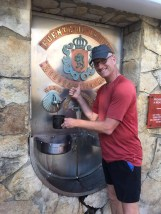 Filling up at a wine fountain