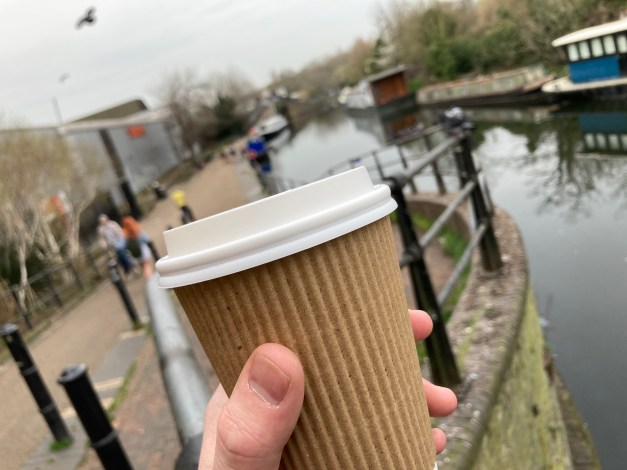 A picture of my coffee cup as I overlook the canal