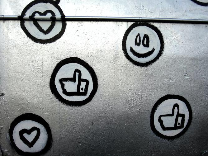 Social media icon graffiti on a wall