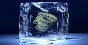 ice_block_with_roll_of_money_frozen_inside_1