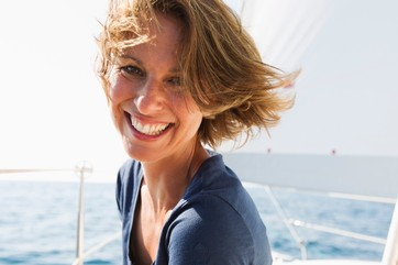 Smiling woman sitting on boat