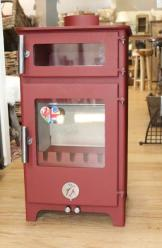 The Hungry Penquin - The Original Chilli Penquin. This stove keeps you warm, cooks dinner, boils your kettle too, and ideal for smaller homes