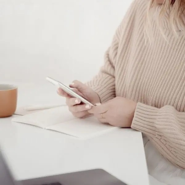 Woman On Phone with Notebook