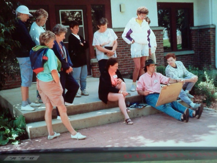 Watercolour Instructor Dean Tatam Reeves providing a group of Lakeland College Summer Art Program students with an outdoor painting demonstration. Vermilion, Alberta, 1994.