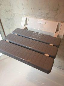 Grey shower seat