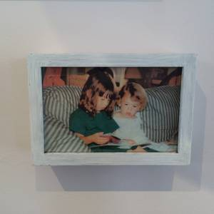 Leah and Bea reading as kids