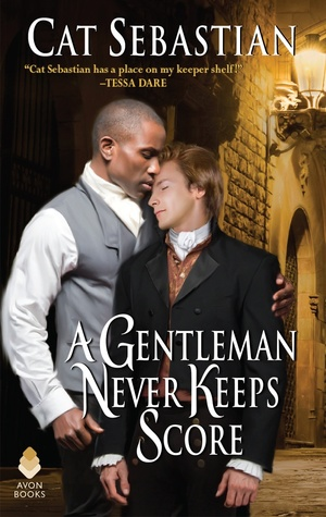 A black man with close-cropped hair wearing a white shirt and a grey waistcoat embraced a shorter white man with fair hair in a dark suit from the side, in front of a Regency-type building lit by lamps