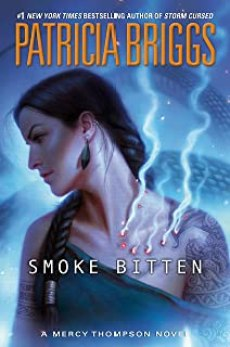 Native American woman with a large bite on the front of her exposed shoulder, from which smoke is pouring