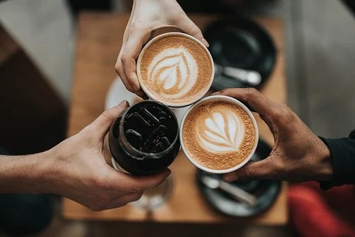 Cheers with coffee